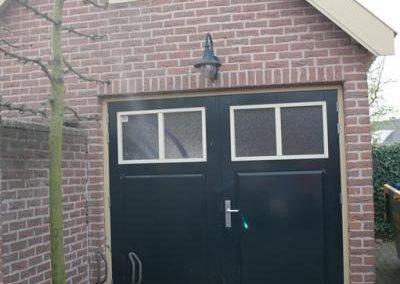 Houten garagedeur rumpt